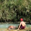 28th August 2018, Saturnia Thermal baths, Tuscany, Italy >< Saturnia is a spa town in Tuscany in north-central Italy that has been inhabited since ancient times. It is a frazione of the comune of Manciano, in the province of Grosseto. Famous for the spa which gives it its name, its population is 280. It lies about 14 km (8.7 mi) from Manciano, 56 km (35 mi) from Grosseto, 37 km (23 mi) northeast of Orbetello and the coast. Near the village, 800 L/s of sulphurous water at 37 °C gushes over a waterfall and down into a cascade of natural pools formed by the deposition of calcareous rock from evaporation of the water. Saturnia takes its name from the Roman god Saturn (or Saturnus). Legend has it that he grew tired of the constant wars of humans, and sent a thunderbolt to earth that created a magic spring of warm sulphurous water which would pacify mankind. Dionysius of Halicarnassus lists Saturnia as one of the towns first occupied by the Pelasgi and then by the Etruscan civilization. A Roman colony arrived in 183 BC, but little is known about it other than the fact that it was a prefecture. There are still remains of the city walls, in the polygonal style, which contain Roman gateways. Roman remains have also been discovered within the town, and remains of tombs outside. These tombs were originally covered by tumuli, which have now disappeared, so that George Dennis, author of Cities and Cemeteries of Etruria, mistook them for megalithic remains. In 1300, Saturnia became the hideout of outlaws and was razed to the ground by the Sienese. Forgotten for several centuries, Saturnia was rediscovered in the late 19th century when the land around the spring was drained and a spa built. Thousands of visitors come to bathe in the waters to this day.